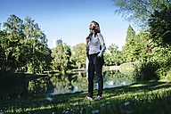 Businesswoman relaxing in the park - KNSF02025