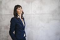Portrait of a pensive businesswoman - KNSF02031