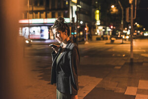 Young businesswoman on the phone at night - UUF11084