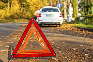 Warning triangle on the road by a car breakdown - PUF00652
