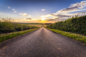 UK, Scotland, East Lothian, empty country road at sunset - SMAF00763