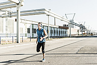 Young athlete jogging in the city - UUF11123