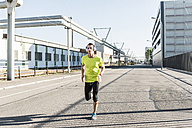 Young athlete jogging in the city - UUF11126