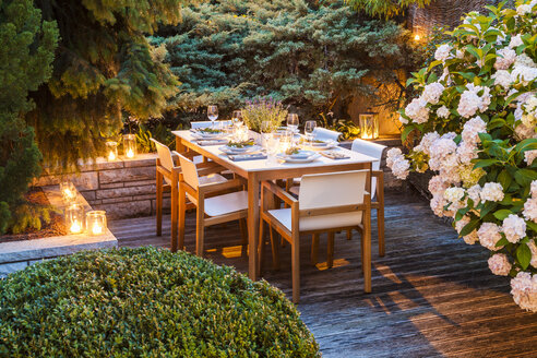 Laid table on lighted terrace - WDF04055