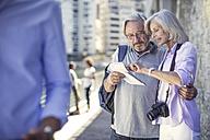 Senior couple taking a city break - ZEF14153