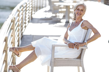 Senior woman relaxing on bench - ZEF14192