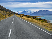 New Zealand, South Island, empty road with Aoraki Mount Cook and Lake Pukaki in the background - STSF01254
