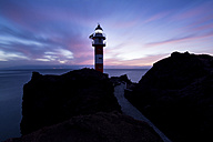 Spain, Tenerife, Punta de Teno Lighthouse at twilight - DHCF00110