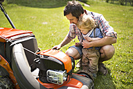 Father with his little son and lawn mower - HAPF01993