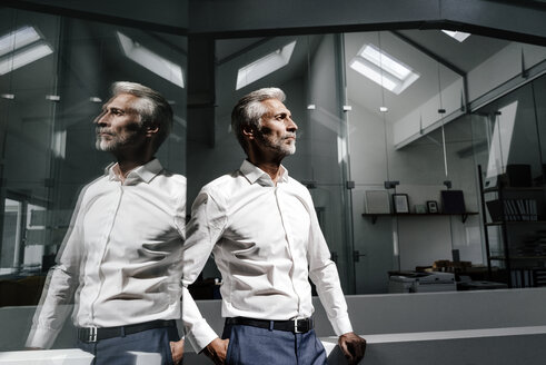 Mature businessman in office thinking - KNSF02112