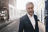 Portrait of confident mature businessman outdoors - KNSF02178