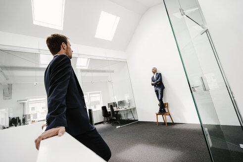 Two businessmen in office - KNSF02193