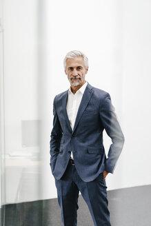 Portrait of confident mature businessman in office - KNSF02199