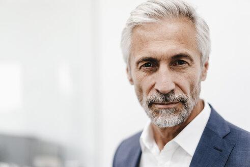 Portrait of confident mature businessman - KNSF02202