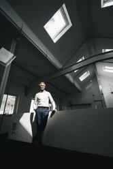 Mature businessman in office - KNSF02211