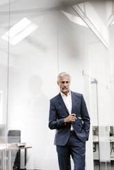 Portrait of serious mature businessman in office - KNSF02217