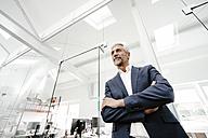 Confident mature businessman in office - KNSF02223