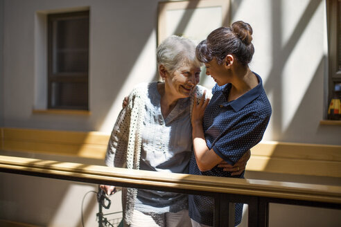 Nurse embracing senior woman in retirement home - ZEF14212