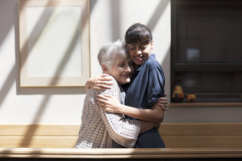Nurse embracing senior woman in retirement home - ZEF14218