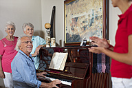 Elderly people making music in retirement home - ZEF14239