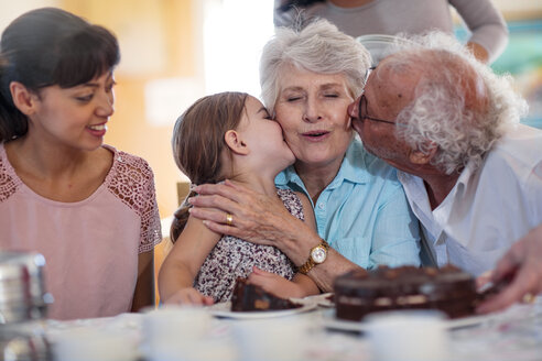 Grandparents celebrating a birthday with their granddaughter - ZEF14257