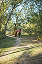 Two active women running in forest - JPF00259