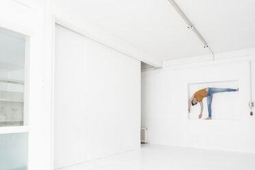 Woman doing gymnastics in niche of a loft - KNSF02246