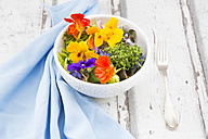Bowl of leaf salad with various edible flowers - LVF06243