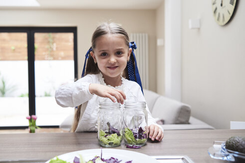 Portrait of little girl helping in the kitchen - IGGF00001