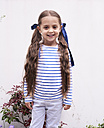 Portrait of smiling little girl with long braids - IGGF00025