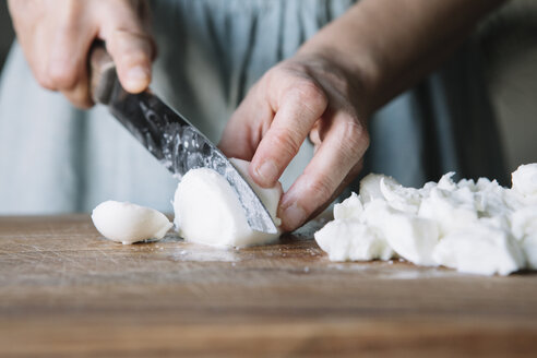 Close-up of woman cutting mozzarella - ALBF00132