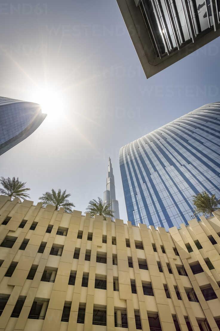 United Arab Emirates, Dubai, Buildings at Emaar Square with Burj Khalifa in the background - NKF00478 - Stefan Kunert/Westend61