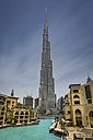 United Arab Emirates, Dubai, Burj Khalifa with Burj Khalifa lake and traditional arabic styled houses of Downtown Dubai district - NKF00481