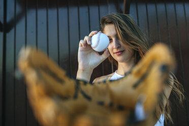 Young woman with baseball and baseball glove - KIJF01688