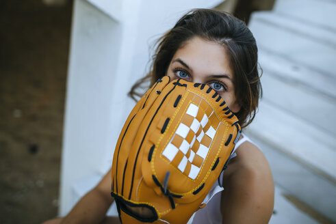 Portrait of young woman with baseball glove - KIJF01694