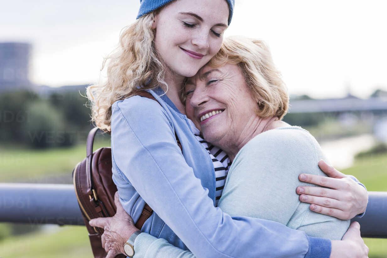 Happy grandmother and granddaughter hugging each other - UUF11368 - Uwe Umstätter/Westend61