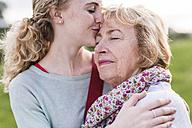 Granddaughter kissing her grandmother - UUF11386