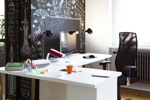 Empty desk in creative office - FKF02456