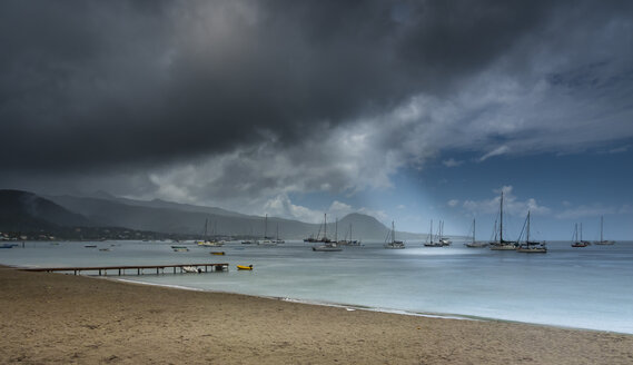Caribbean, Antilles, Dominica, Cabrits National Park, Moored sailing boats under stormy clouds - AMF05410