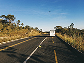 Brazil, Alto Paraiso de Goias, Camper on a country road - JUBF00248