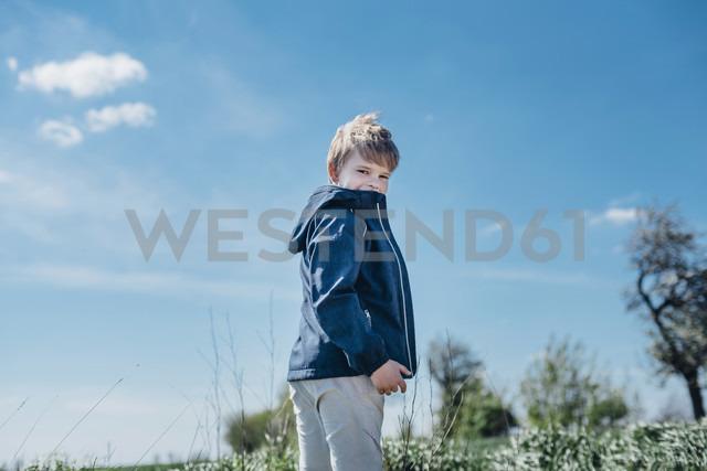 Smiling boy standing against blue sky - MJF02153