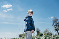 Smiling boy standing against blue sky - MJF02153