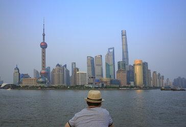 China, Shanghai, back view of man looking at Pundong - EAF00016