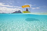 Oceania, Bora Bora, tourist in moored boat - WLF00022
