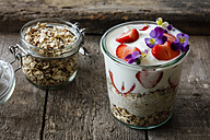 Glass of granola with natural yogurt, strawberries and Horned Violets - EVGF03262