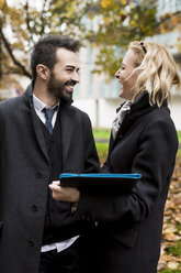 Happy business couple in the city - MAUF01179