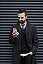 Businessman looking at cell phone - MAUF01188