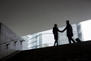 Businessman and businesswoman meeting in the city - MAUF01194