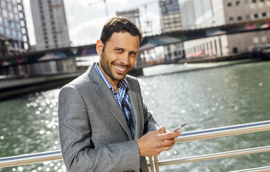 Portrait of a smiling businessman in the city - MGOF03524