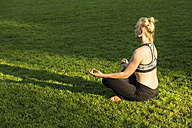 Woman doing yoga in park - JFEF00852